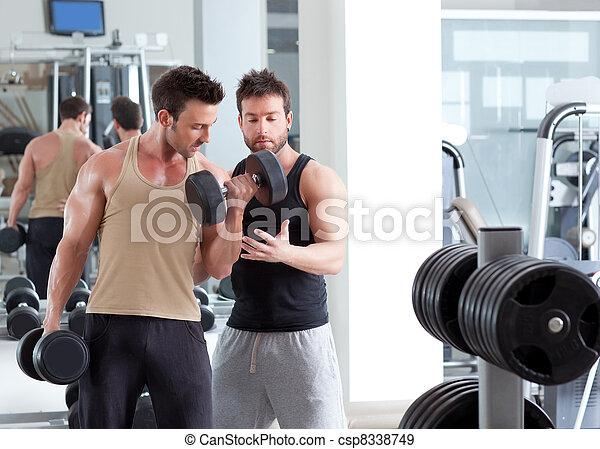 gym personal trainer man with weight training - csp8338749