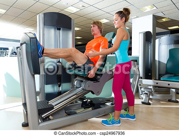 Gym seated leg press machine blond man workout - csp24967936
