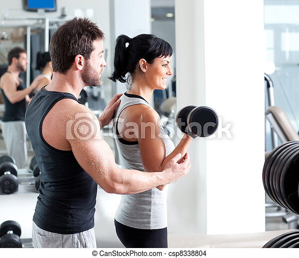 gym woman personal trainer with weight training - csp8338804