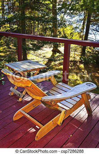 Der Stuhl auf dem Cottage Deck - csp7286288