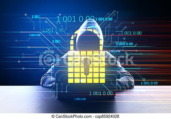 Hacker at desktop using laptop with glowing padlock hologram. - csp85924028
