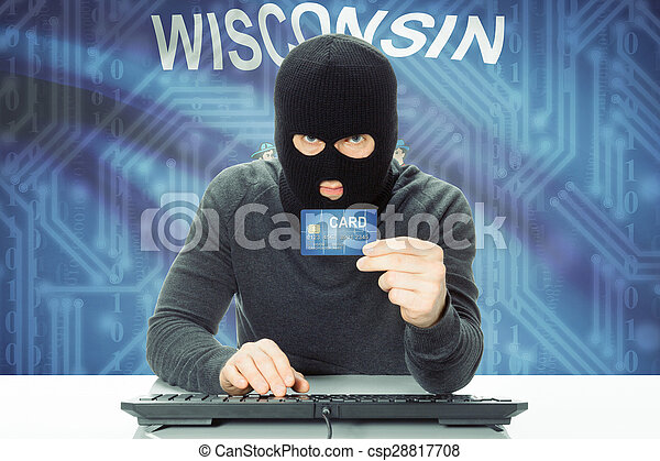 Hacker holding credit card and USA state flag on background - Wisconsin - csp28817708