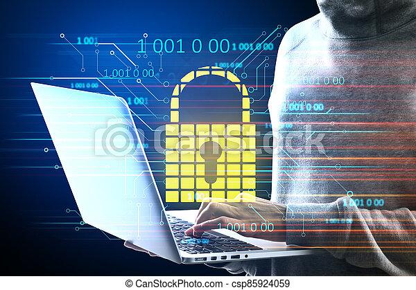 Hacker holding laptop with glowing padlock hologram. - csp85924059