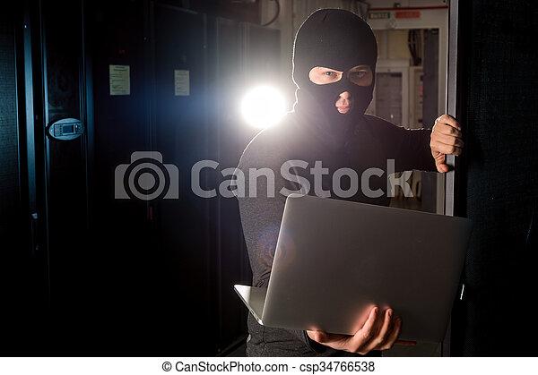Hacker in a datacenter - csp34766538