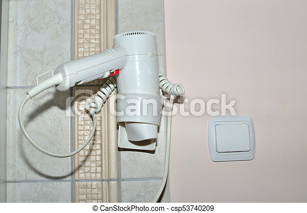 Hair dryer in a bathroom - csp53740209