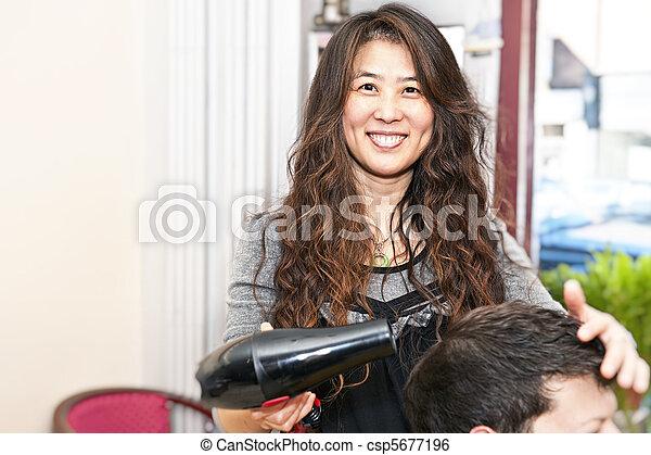 Hair stylist working - csp5677196