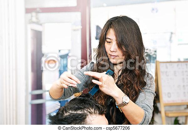 Hair stylist working - csp5677206