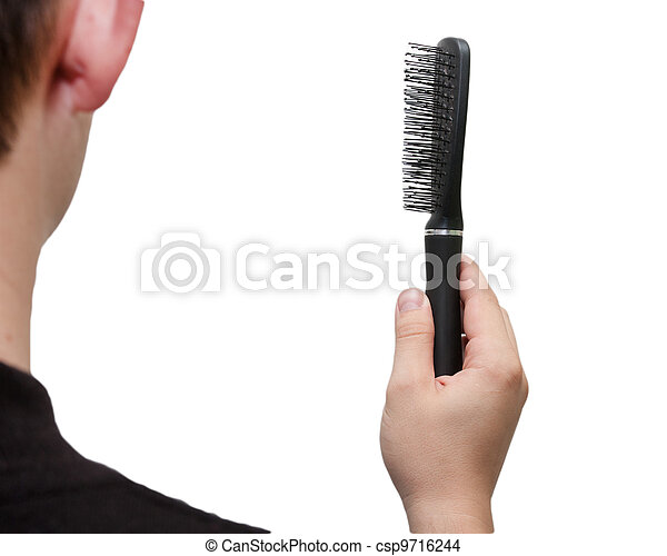 hairbrush in her hand a man on a white background - csp9716244