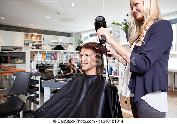 Hairdresser Drying Customer's Hair - csp10181014