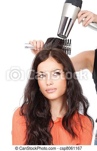 hairdresser is drain a long black hair - csp8061167