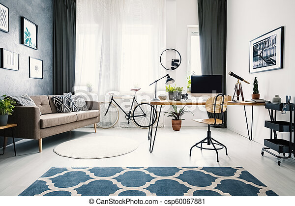 Hairpin table with retro telescope, mockup computer, fresh plants and lamp  standing in modern living room interior with two carpets, windows with ...