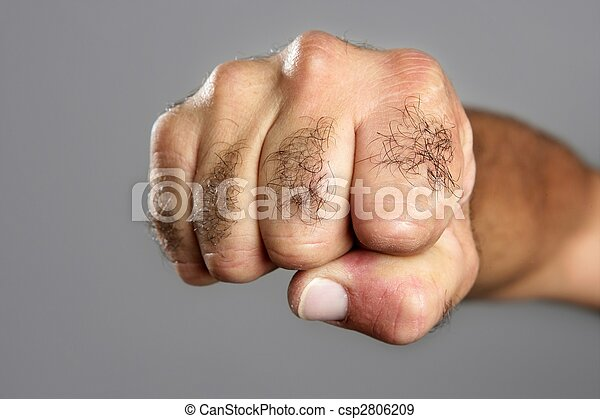 Hairy man fist closeup expression over gray - csp2806209