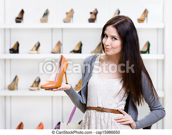 Half-length portrait of woman keeping shoe - csp15986650