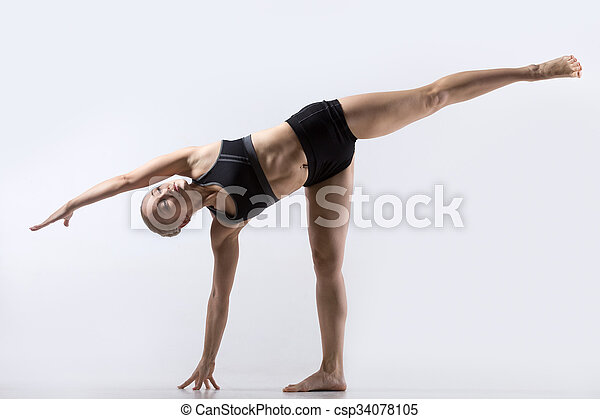 sporty beautiful young woman practicing yoga standing in