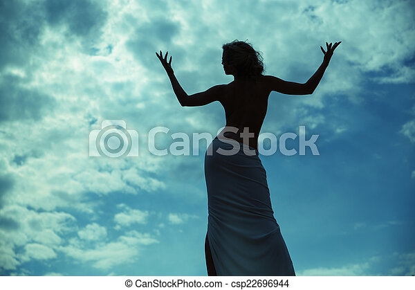 Half-naked woman posing over the blue sky - csp22696944