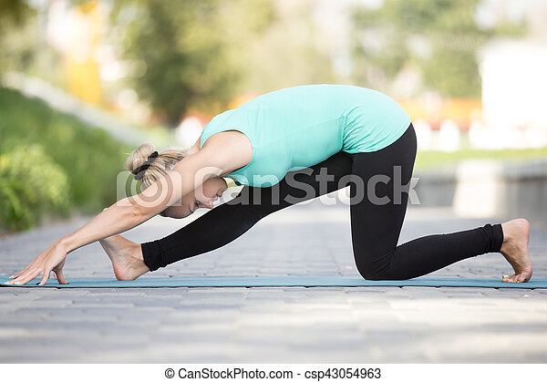 half splits pose sporty attractive young woman practicing