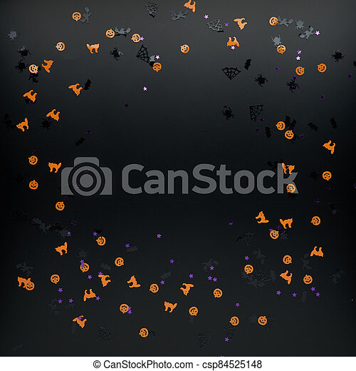 Halloween decorations. Confetti on black background. Halloween concept. Flat lay, top view, copy space - csp84525148