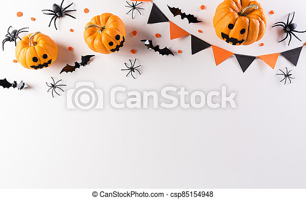 Halloween decorations made from pumpkin, paper bats and black spider on white background. Flat lay, top view with copy space for text. - csp85154948