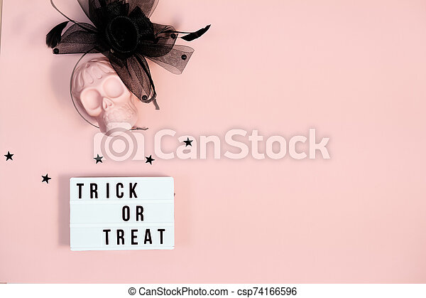 Halloween decorations on pastel pink background. Halloween concept. Flat lay, top view, copy space - csp74166596