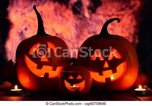 Halloween Jack o Lanterns with orange grunge background - csp60709646
