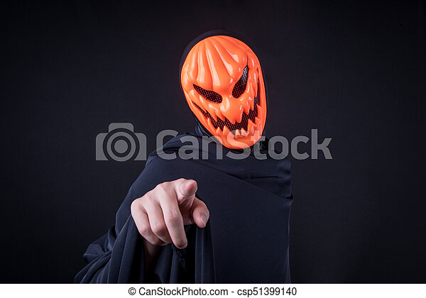 Halloween Maan.Halloween Man With Pumpkin Mask On Black Background