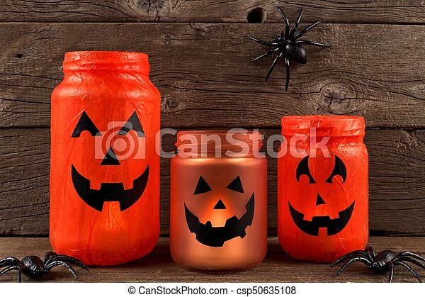 Halloween mason jar Jack o Lanterns - csp50635108
