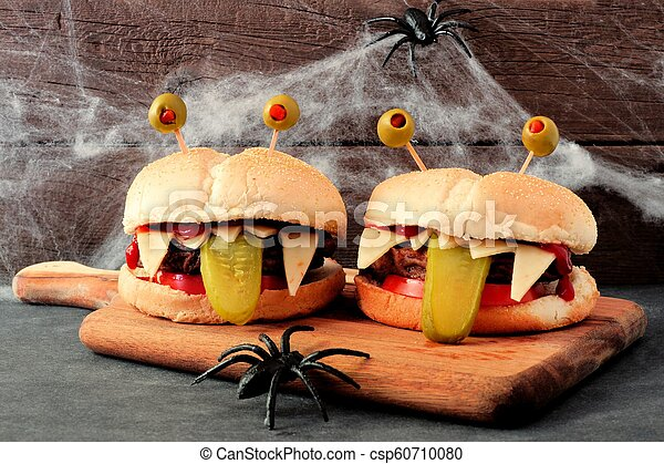 Halloween Hamburgers.Halloween Monster Hamburgers On A Paddle Board With Spider Web Background