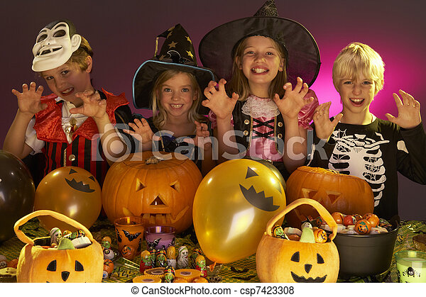 Halloween party with children wearing fancy costumes - csp7423308