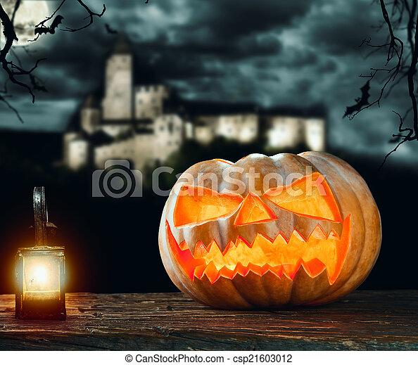 Halloween pumpkin on wood with dark background - csp21603012