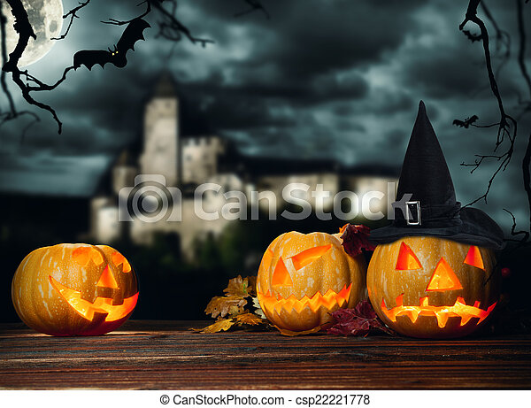 Halloween pumpkins on wood with dark background - csp22221778