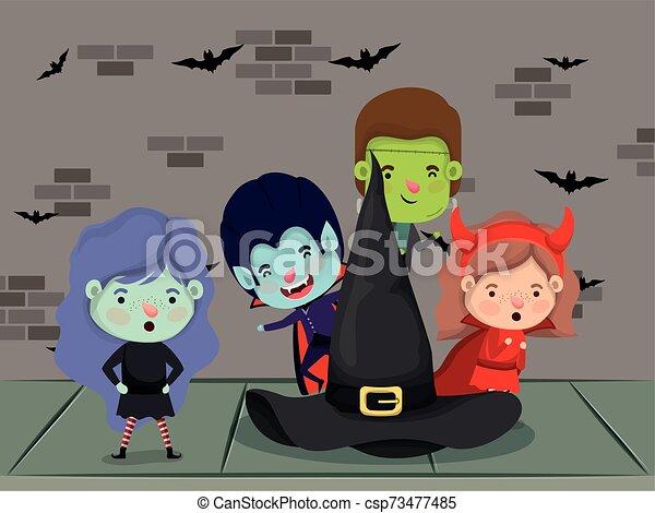 halloween season scene with kids costume - csp73477485