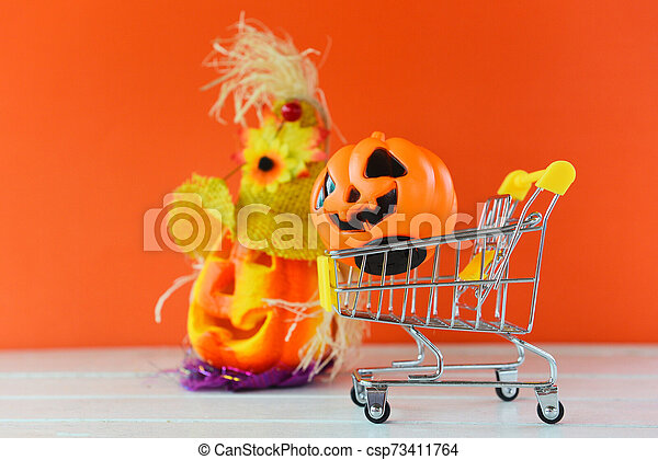 Halloween Pumpkin Accessories.Halloween Shopping Holiday Concept Accessories With Pumpkin Jack O Lantern In A Shopping Cart On Orange Background Canstock