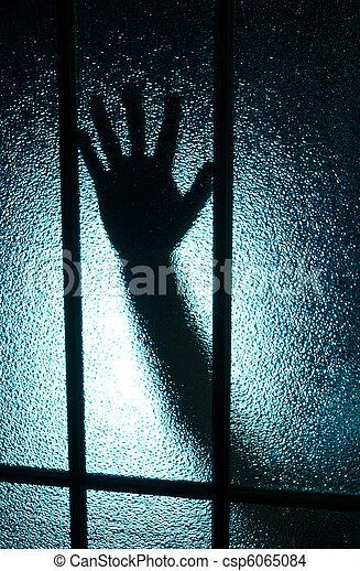 Hand behind glass - csp6065084