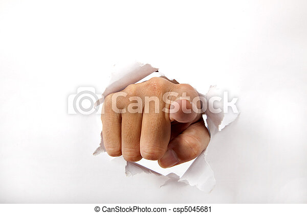 hand break through the white paper with finger pointing to the you - csp5045681