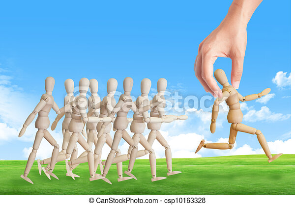 Hand choosing the perfect candidate for the job. Human resource concept - csp10163328