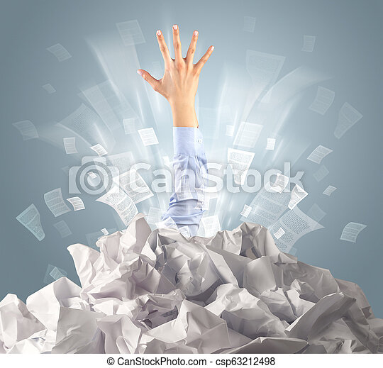 Hand coming out from paper pile - csp63212498