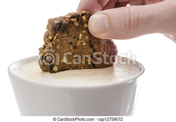Hand dipping a cookie in cocoa - csp12759072