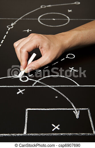Hand drawing a soccer game strategy - csp6907690