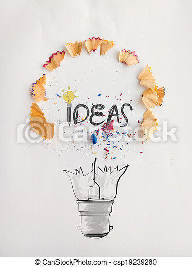 hand drawn light bulb word design IDEA with pencil saw dust on paper background as creative concept - csp19239280