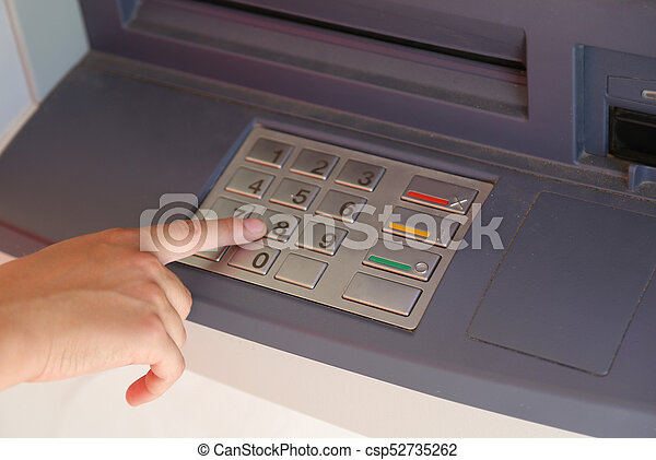 hand enter the secret code on the keypad of the ATM to withdraw