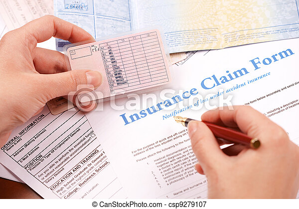 hand filling in insurance claim form - csp9279107