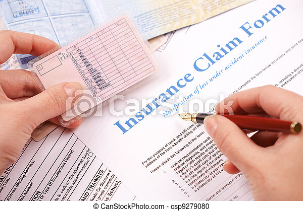hand filling in insurance claim form - csp9279080