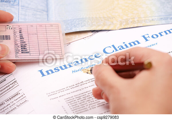 hand filling in insurance claim form - csp9279083