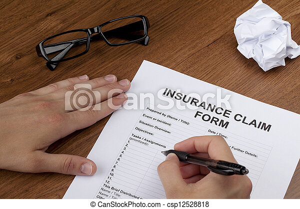 hand filling in the insurance form - csp12528818