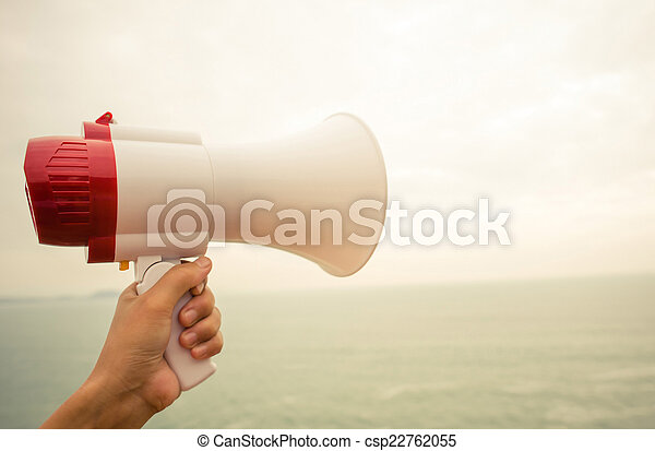 hand hold megaphone seaside - csp22762055