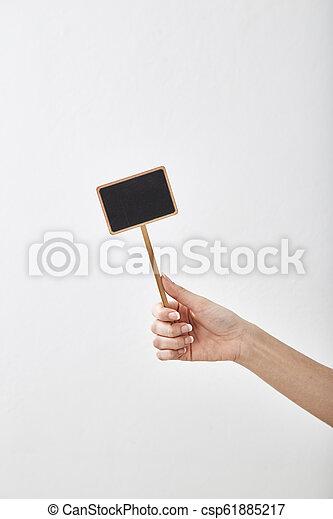 hand holding a blank blackboard label - csp61885217