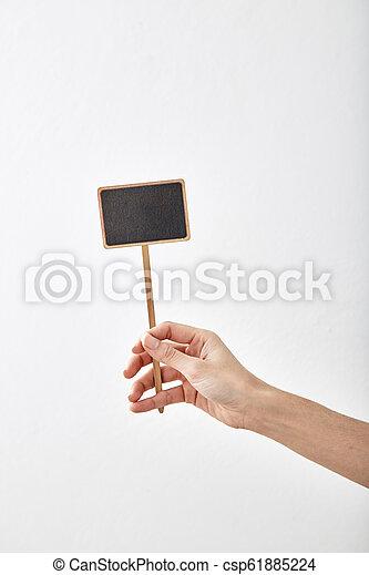 hand holding a blank blackboard label - csp61885224