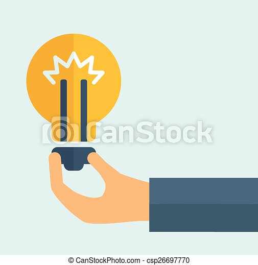 Hand holding a bulb. - csp26697770