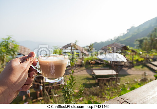 Hand holding a coffee cup - csp17431469