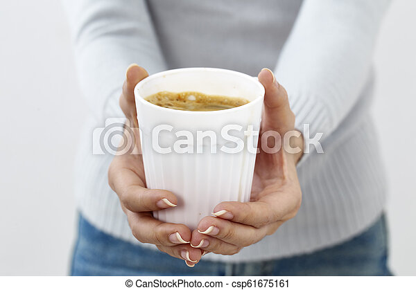 hand holding a coffee cup - csp61675161